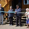 Ribbon cutting ceremony at Round Lake Hall.  Mabel Forsyth, daughter of Round Lake Tommy.